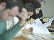 Students studying at a manuscript workshop